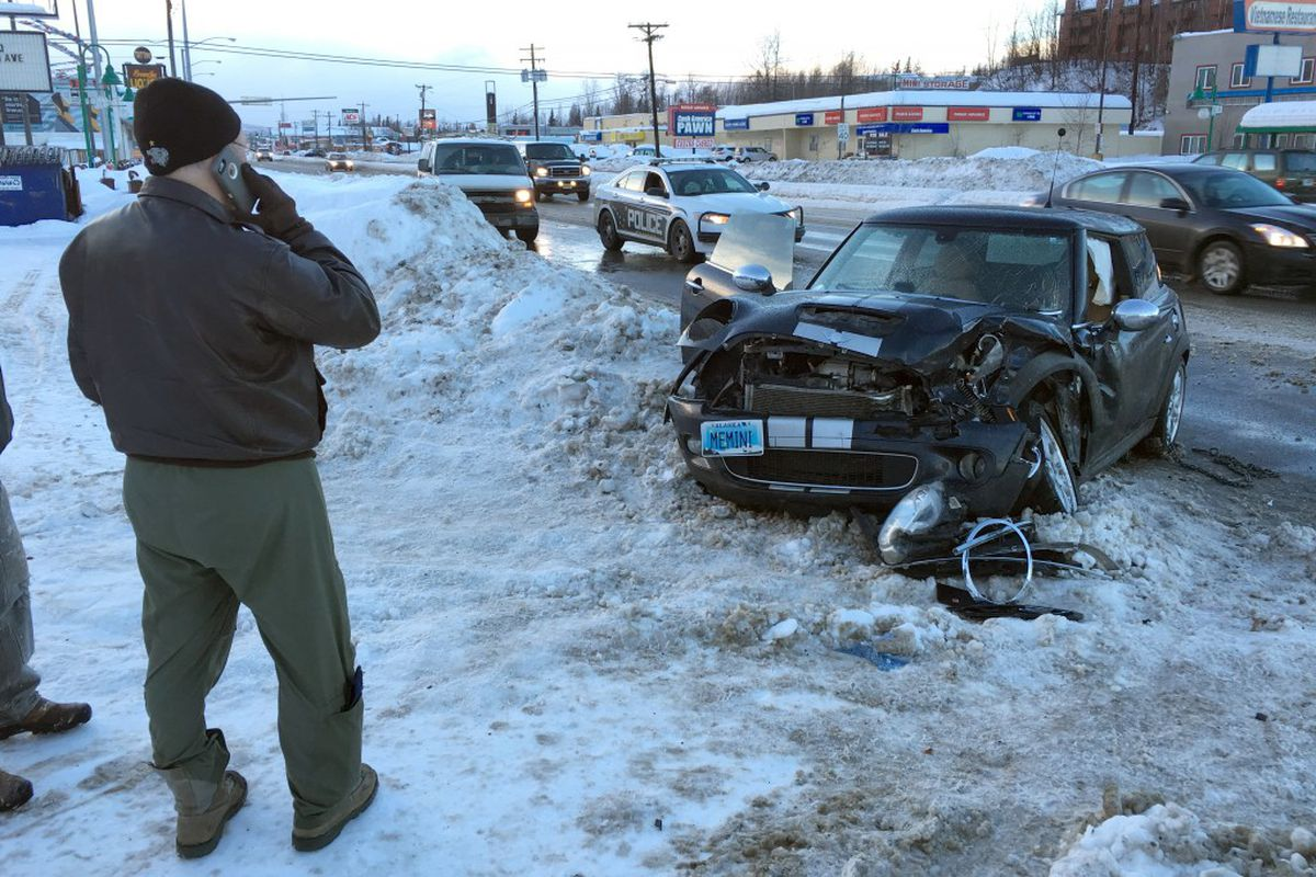 An accident on Muldoon Road near Boundary left two cars damaged and traffic slowed Thursday. (Bob Hallinen / Alaska Dispatch News)