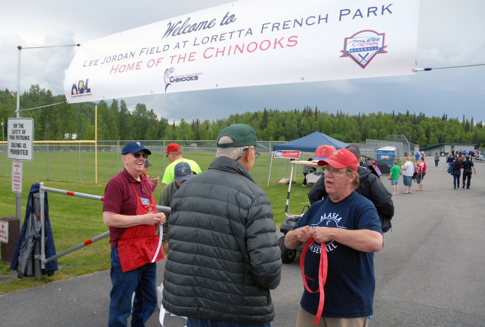 Knights of Columbus members Raymond Berry, left, and Ken Kutney hand out tickets before the start of a Chinooks game. (Matt Tunseth / Chugiak-Eagle River Star)