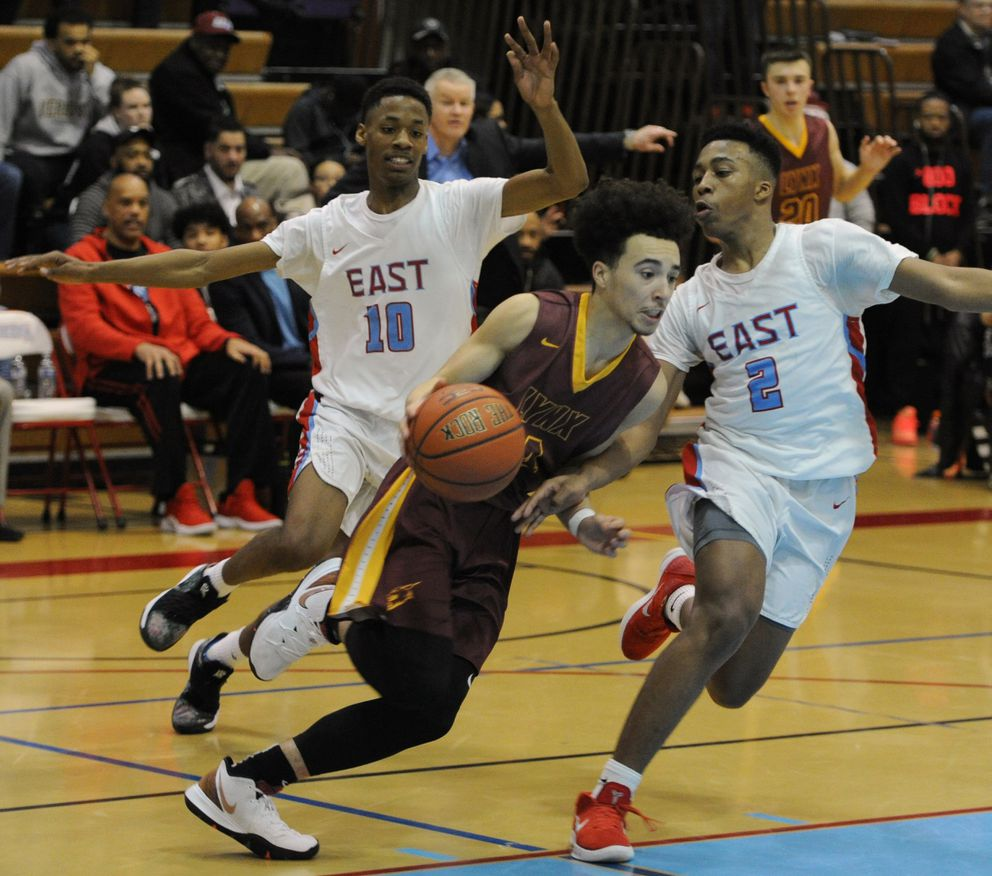 Dimond High junior Isaiah Moses attempts to move the ball down court past East High defenders Jaron Williams (10) and Hasaan Herrington (2) during the Lynx 52-45 victory over the Thunderbirds at East High on Tuesday evening, Feb 19, 2019. (Bill Roth/ ADN)