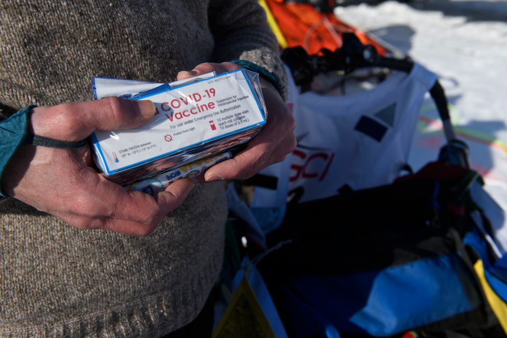 Larry Daugherty, a musher from Eagle River, will carry empty packages of COVID-19 vaccine with him on the trail this year. Forty-six mushers began the 2021 Iditarod Trail Sled Dog race from Deshka Landing in Willow on March 7, 2021. (Marc Lester / ADN)