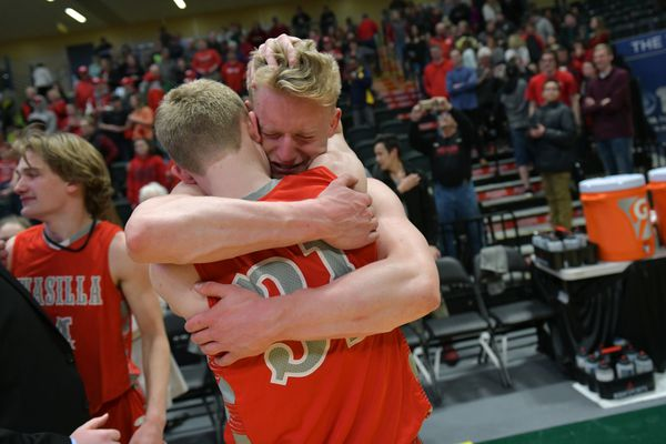 Reilly Devine hugs Luke Devine after the game ends. Wasilla beat Dimond, 47-44, in the boys basketball 4A state championship on March 24, 2018. (Marc Lester / ADN)