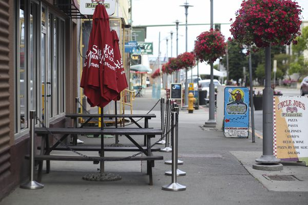 Empty outdoor seating tables line G Street in Anchorage on July 31, 2020. (Emily Mesner / ADN)