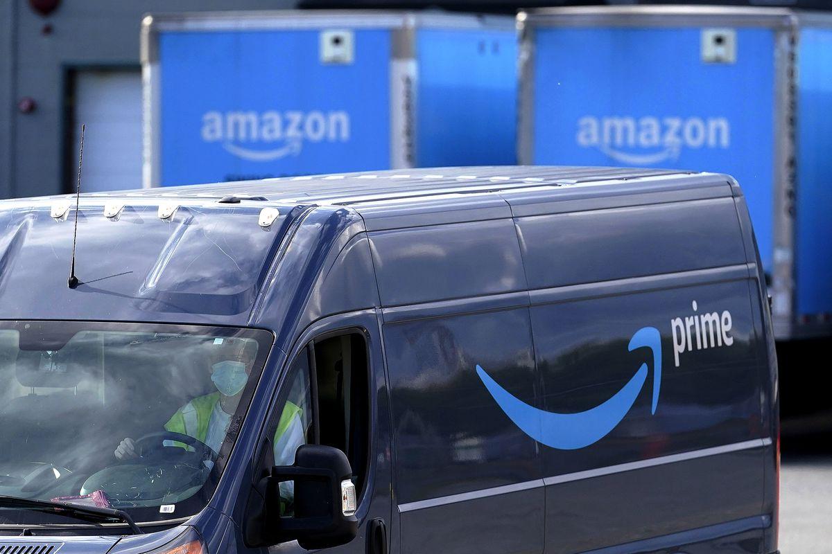 An Amazon Prime delivery van departs an Amazon Warehouse in Dedham, Mass. (AP Photo/Steven Senne, File)
