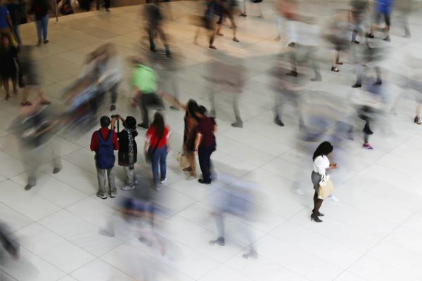 FILE - In this June 15, 2017, file photo, people walk inside the Oculus, the new transit station at the World Trade Center in New York. According to figures released Monday, Dec. 30, 2019, by the U.S. Census Bureau, the past year's population growth rate in the United States was the slowest in a century due to declining births, increasing deaths and the slowdown of international migration. (AP Photo/Frank Franklin II, File)
