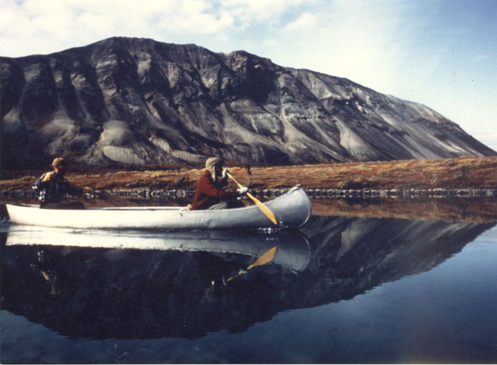 Dick Proenneke, stern, and John Branson paddle Proenneke's canoe in Lake Clark National Park and Preserve in about 1983. (Fred Hirschmann)