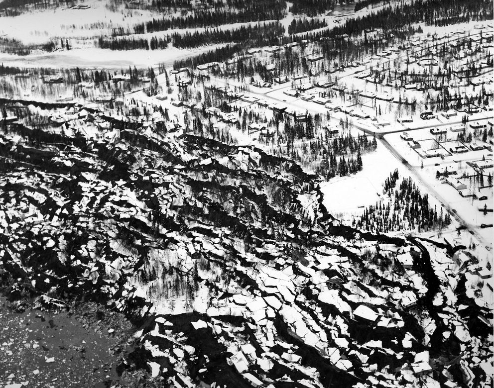 Aerial view of damage in the Turnagain area of Anchorage after the March 27, 1964 earthquake, showing collapsed coastal bluffs. (U.S. Army Corps of Engineers/ ADN archive)