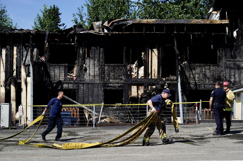 Anchorage police and firefighters respond to an apartment fire on Saturday, July 31, 2021 in Eagle River. (Loren Holmes / Anchorage Daily News)