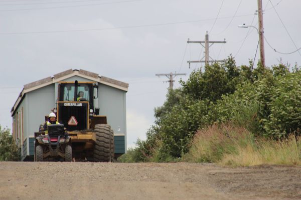 Teacher housing for the school in Clarks Point was moved from beach to gravel pad Tuesday, Aug. 15, 2017. The school is scheduled to be moved to its place on gravel pad this Thursday, Aug. 17, 2017. (Shannon Harvilla)