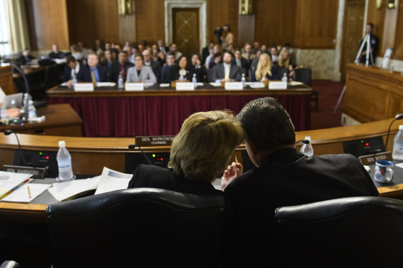 Sen. Lisa Murkowski, chair of the Senate Energy and Natural Resources Committee talks with ranking member Sen. Joe Manchin, D-West Virginia, during a hearing on June 18, 2019. (Marc Lester / ADN)
