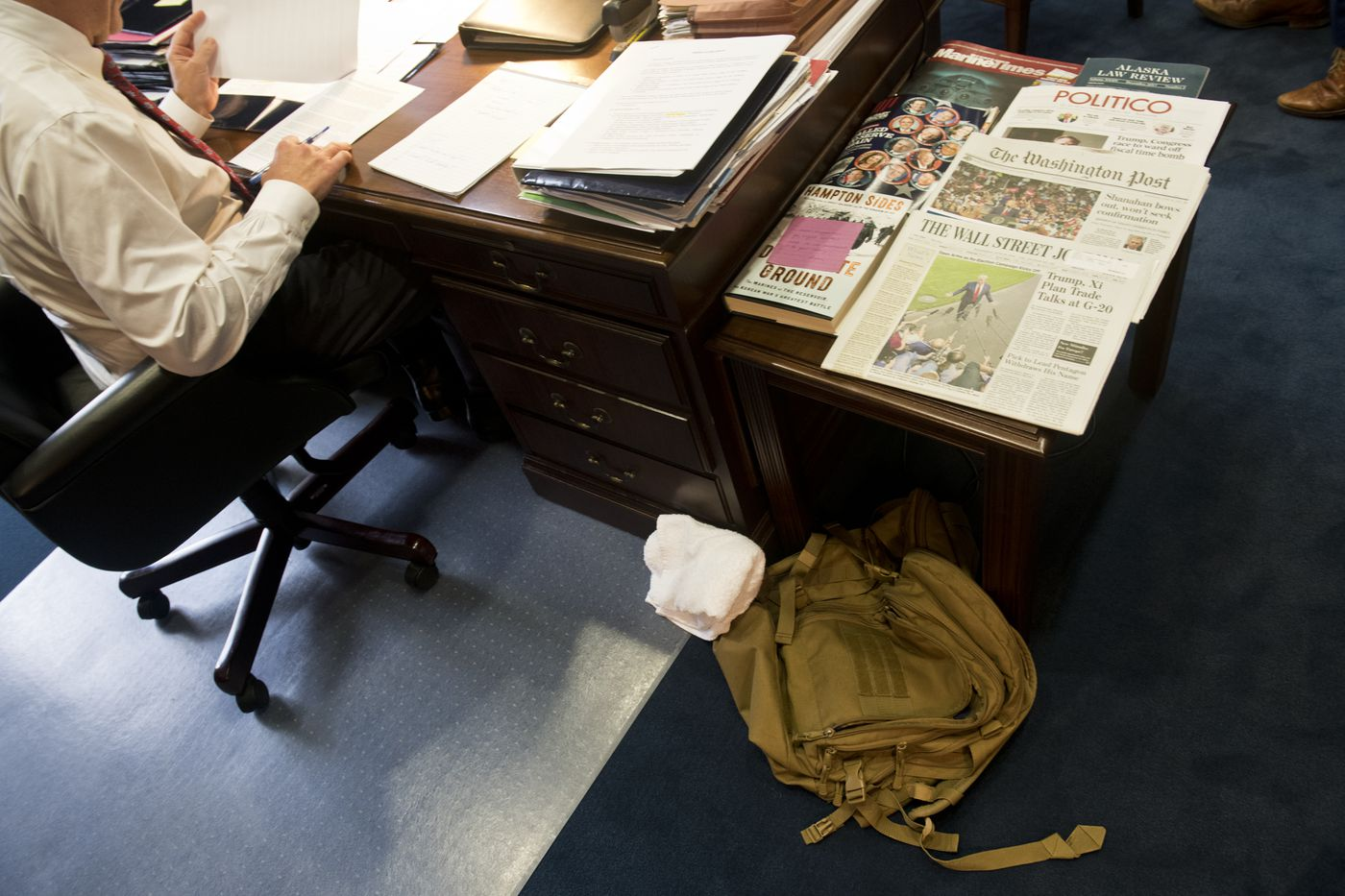 A military-issue backpack sits on the floor next to Sen. Dan Sullivan's desk on June 19, 2019. Sullivan is a Marine Corp veteran and a colonel in the Marine Corp Reserve. (Marc Lester / ADN)
