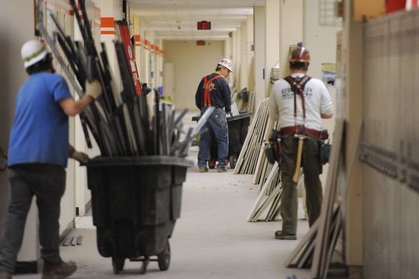 Workers from Roger Hickel Contracting work in the 5th floor hallway as cleanup of debris and repair continued at Bartlett High School on Sunday, Dec. 2, 2018 after Friday's 7.0 earthquake. (Bill Roth / ADN)