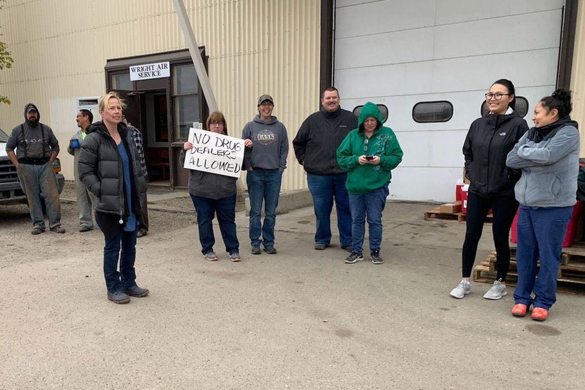 Dozens of residents of Galena gathered at the airport on Wednesday, Aug.28, 2019 and gave a suspected drug dealer who had just landed a choice. (Photo provided by Cynthia Erickson)