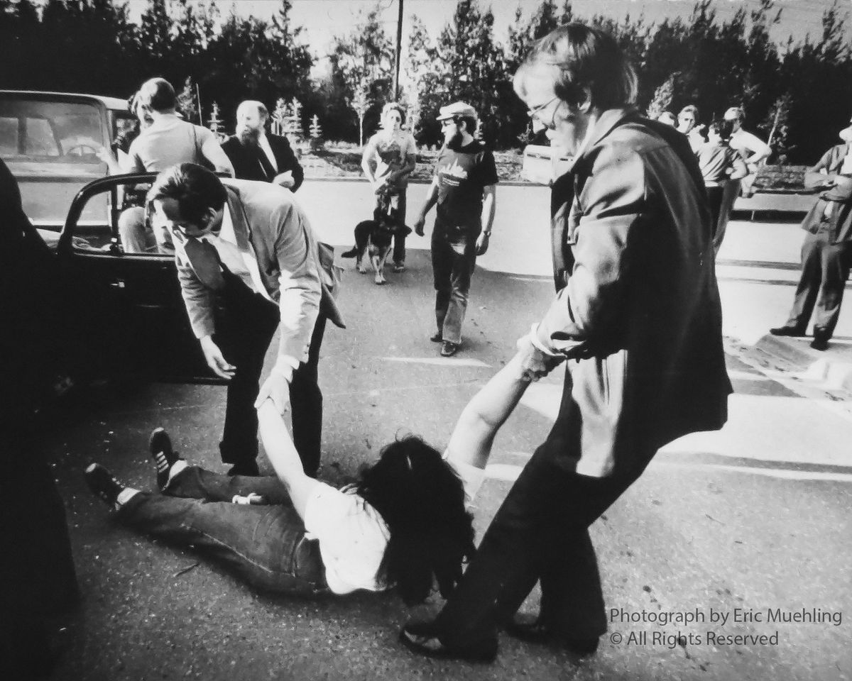 Mona Oliver is dragged from her car by IRS agents outside the federal building in Fairbanks in 1979. (Eric Muehling/Fairbanks Daily News-Miner)
