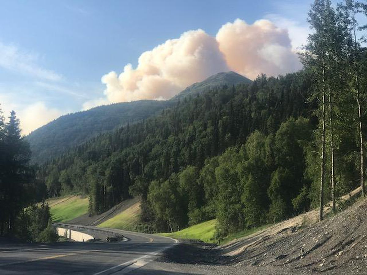 A plume of smoke rises from the Swan Lake Fire, July 1, 2019. (Alaska Division of Forestry)