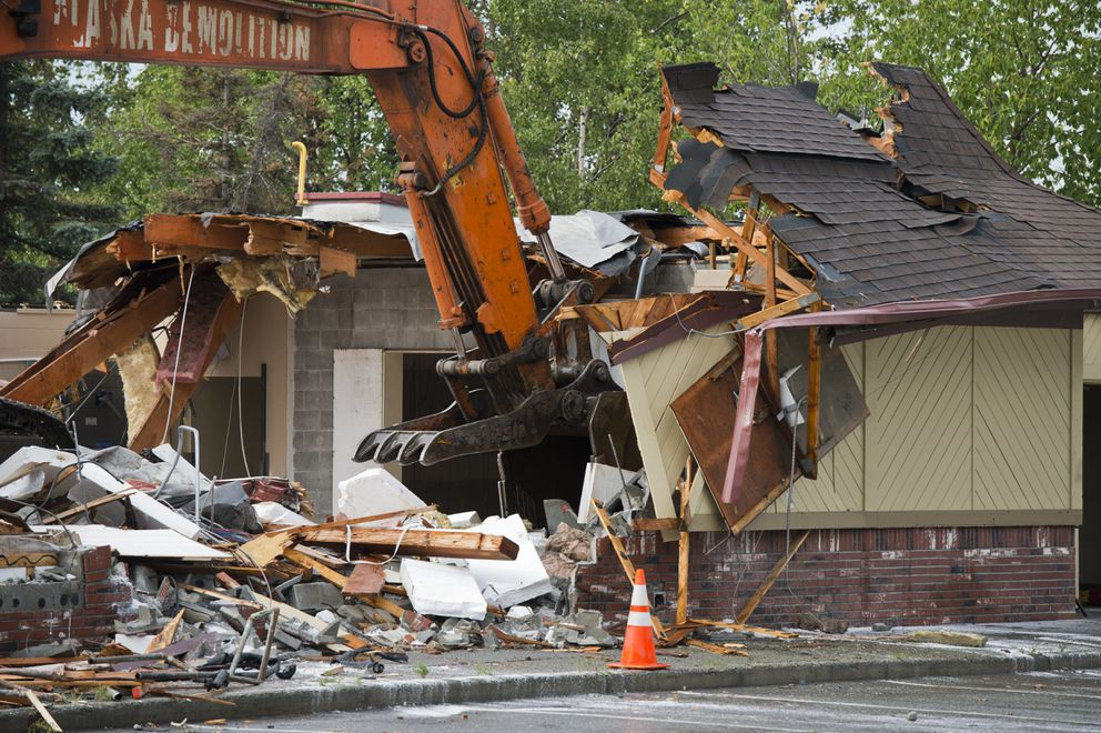 In August 2019, a crew from Alaska Demolition tears apart the Eagle River McDonald's, which was closed due to damage from the Nov. 30, 2018 earthquake. Store owner Mike Davidson has said he plans to tear the building down and rebuild in the same location alongside the Old Glenn Highway in downtown Eagle River. (Marc Lester / ADN archive)