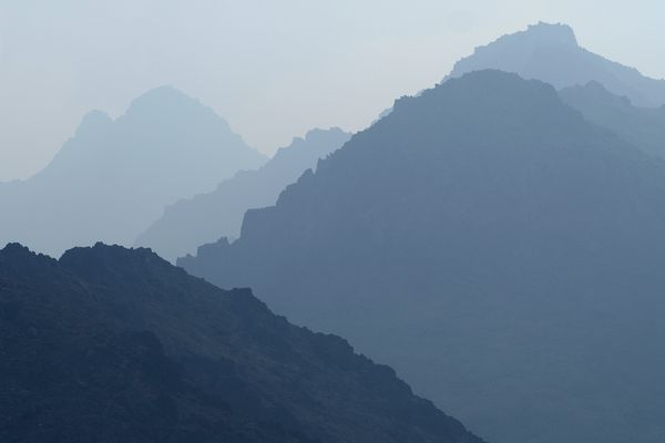 Smoke hazes the view of ridges near Peak Two and Ptarmigan Peak in Chugach State Park on August 20, 2019. (Marc Lester / ADN)