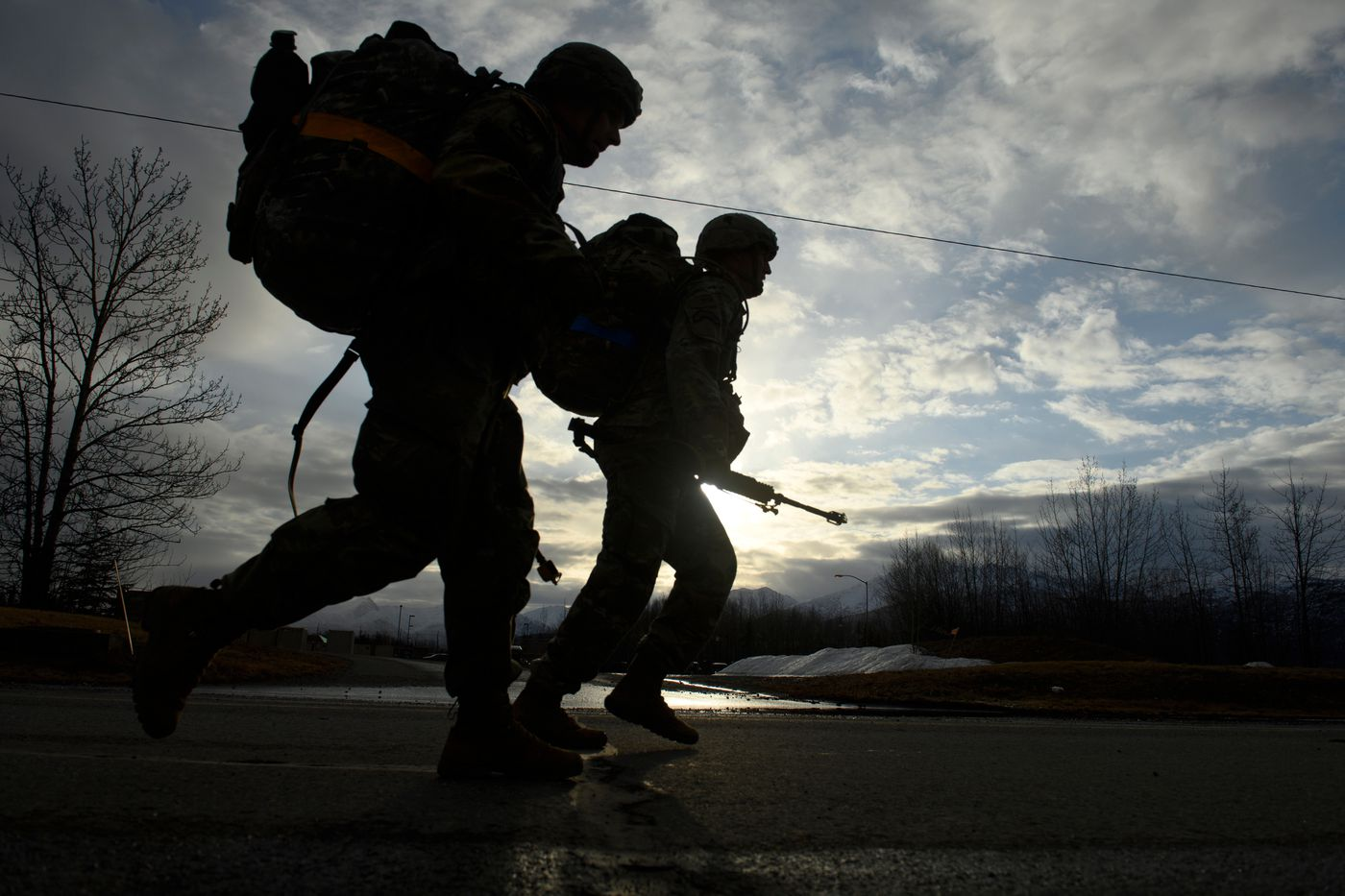 Paratroopers finish a 12-mile road march carrying about 70 pounds of gear on April 30, 2021, the final day of testing. (Marc Lester / ADN)