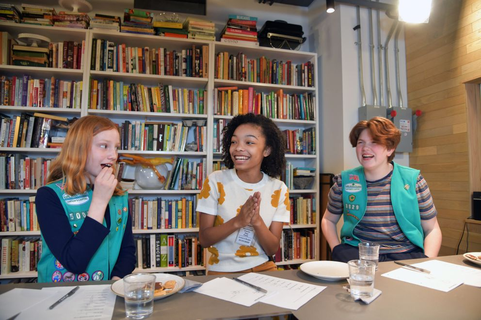From left to right, Mae Maney, 10, Kimorra Buggs, 13 and Ross Donlan, 13 discuss the the various flavors of girl scout cookies. Washington Post photo by Marvin Joseph.