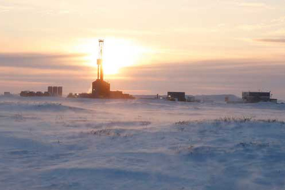 The Kuukpik 5 rig is seen at sunset while drilling the ConocoPhillips' Putu well south of Nuiqsut in mid-February 2018. (Judy Patrick / ConocoPhillips)