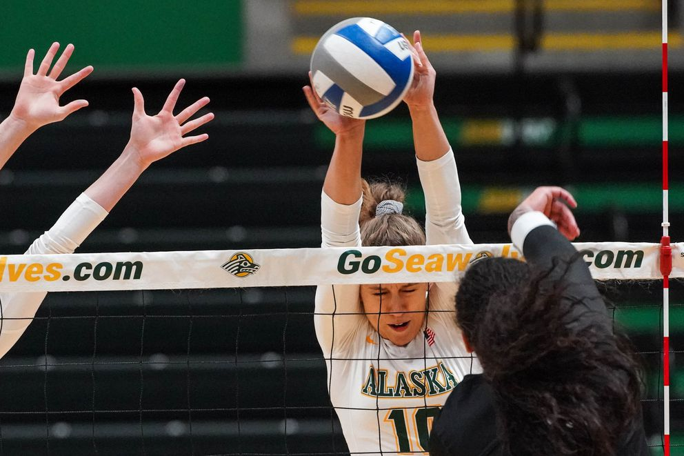 UAA's Hannah Pembroke contributes to UAA's front-row defense. (Loren Holmes / ADN)