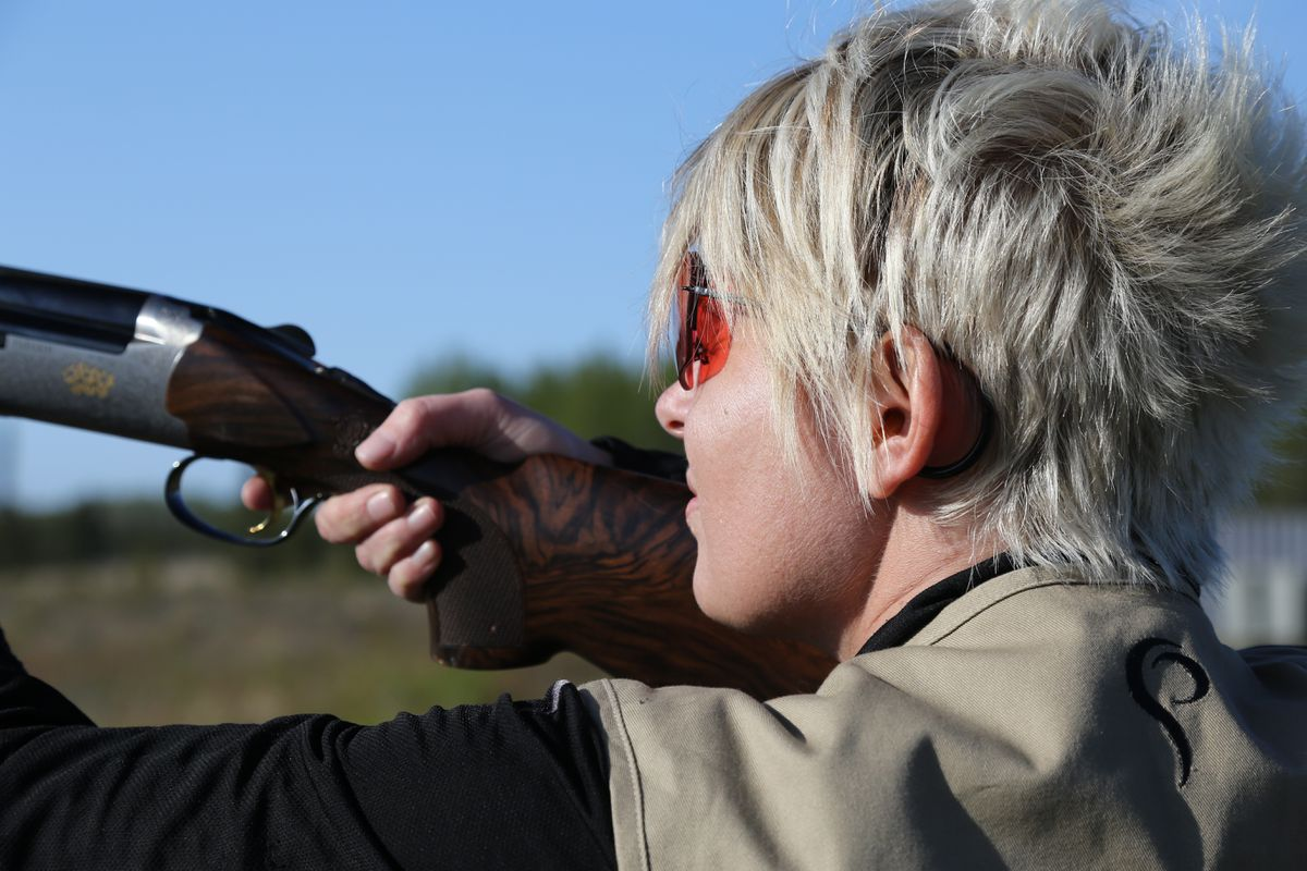 Christine Cunningham mounts a shotgun. (Photo by Steve Meyer)
