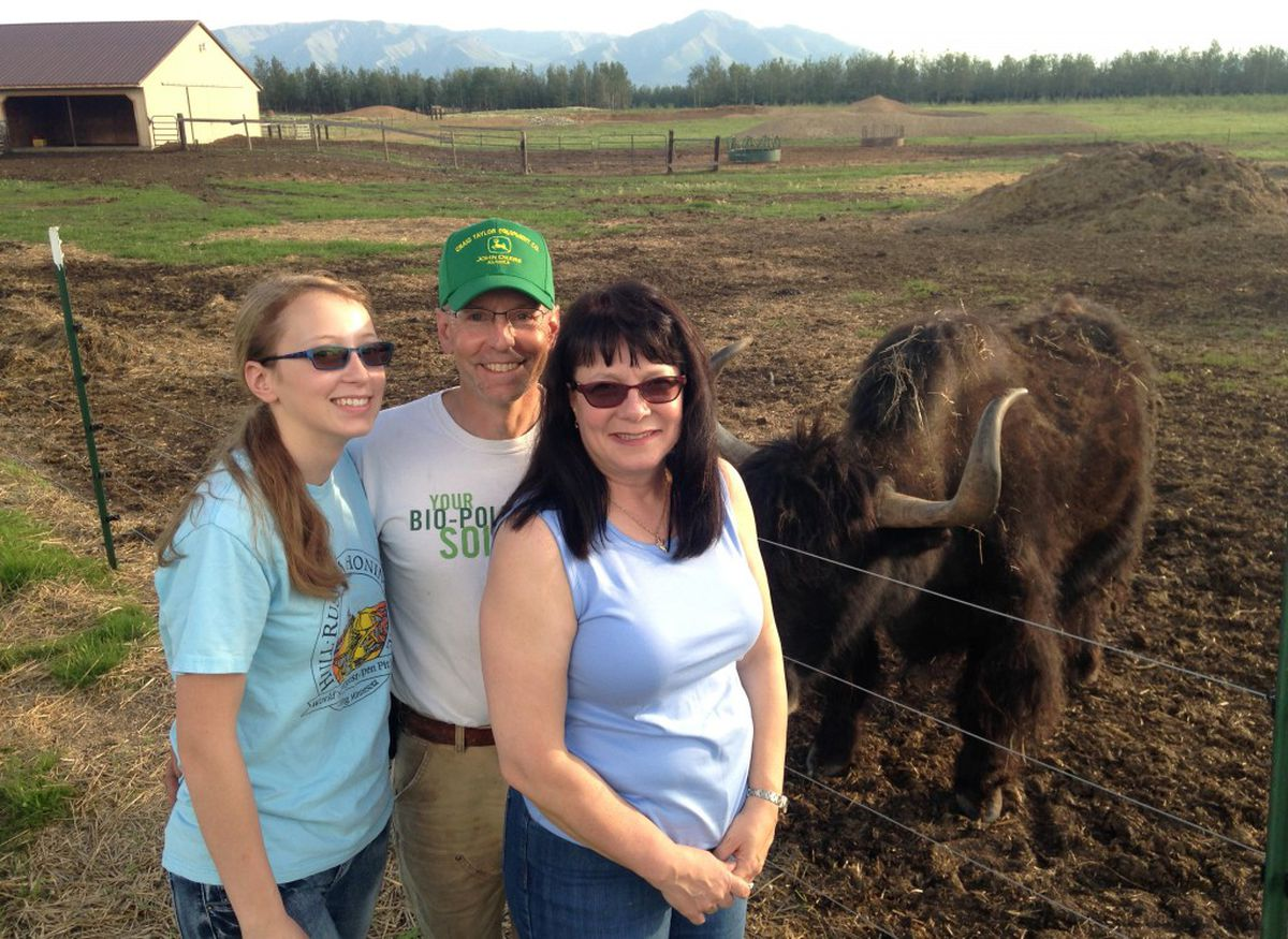 The Kaspari family, from left, Grace, Phil and Mary, with yak, Demitri. The family farm east of Delta has 125 head of yak. (Charles Wohlforth / Alaska Dispatch News)