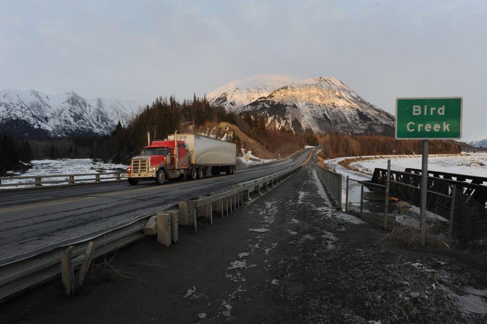 Motorists travel the Seward Highway at Bird Creek on Monday. (Bill Roth / Alaska Dispatch News)