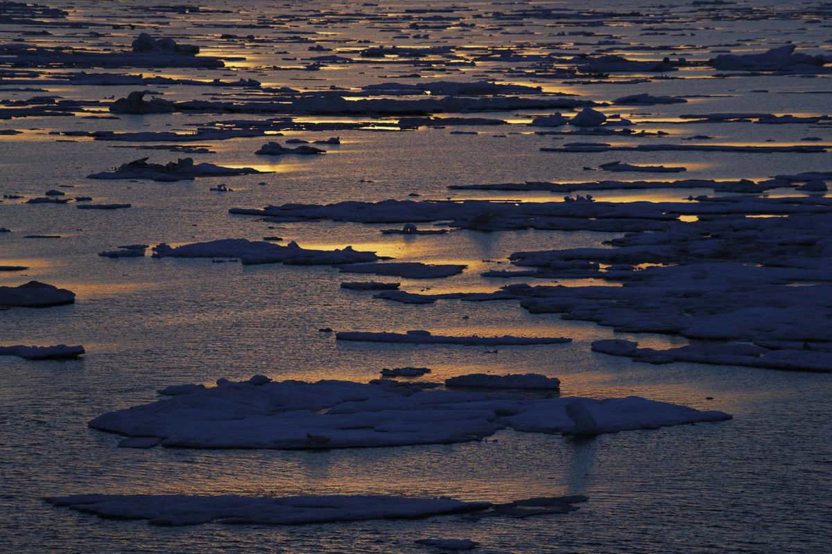 FILE - In this July 21, 2017, file photo, the sun sets over sea ice floating on the Victoria Strait along the Northwest Passage in the Canadian Arctic Archipelago. (AP Photo/David Goldman)