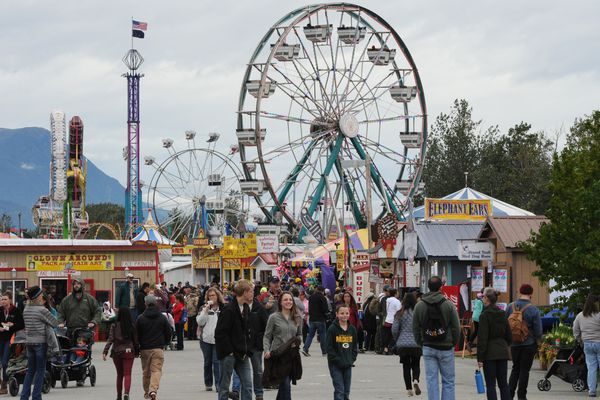 People walk through the fair grounds on the opening day of the Alaska State Fair in Palmer on Thursday, Aug. 24, 2017. (Bill Roth / Alaska Dispatch News)
