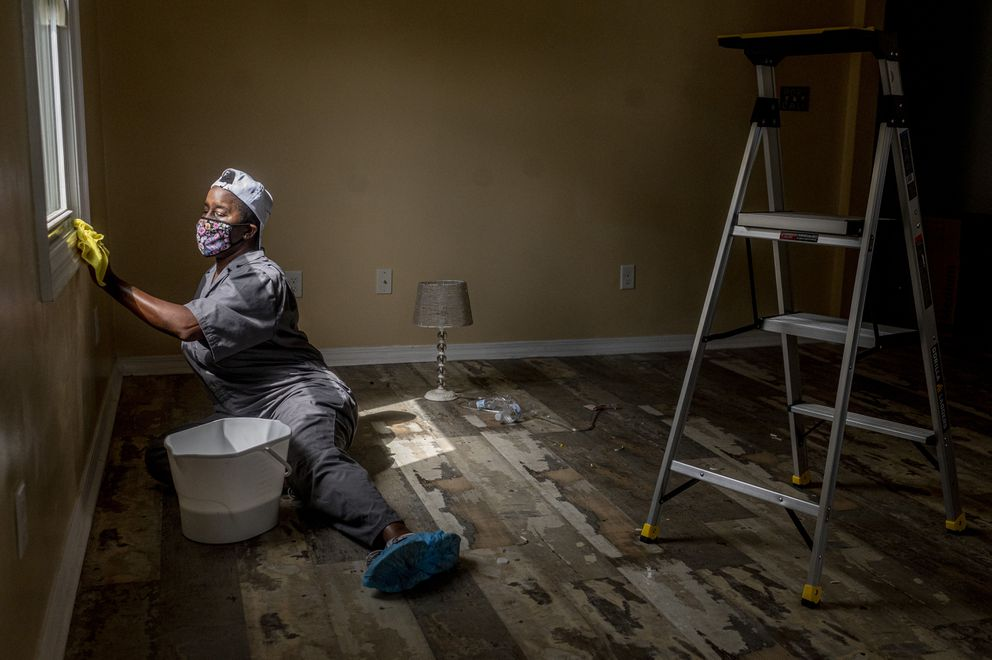Ally Detrick cleans a client's home for a reduced rate in New Orleans on Saturday, Sept 27, 2020. (Photo for The Washington Post by Emily Kask)