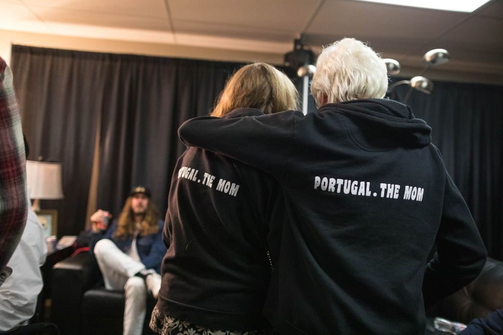 Susan Morgan, left, and Terrie Paine wear hoodies that read 'Portugal. The Mom, ' backstage after the band's show Friday, Oct. 26, 2018 at the Alaska Airlines Center. Morgan's son Eric Howk plays guitar and Paine's son Kyle O'Quin plays keyboards in the band Portugal. The Man. (Loren Holmes / ADN)