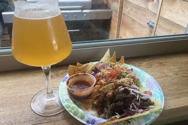 Tasty Traveler food truck tacos with beer from Anchorage Brewing Company. (Mara Severin)