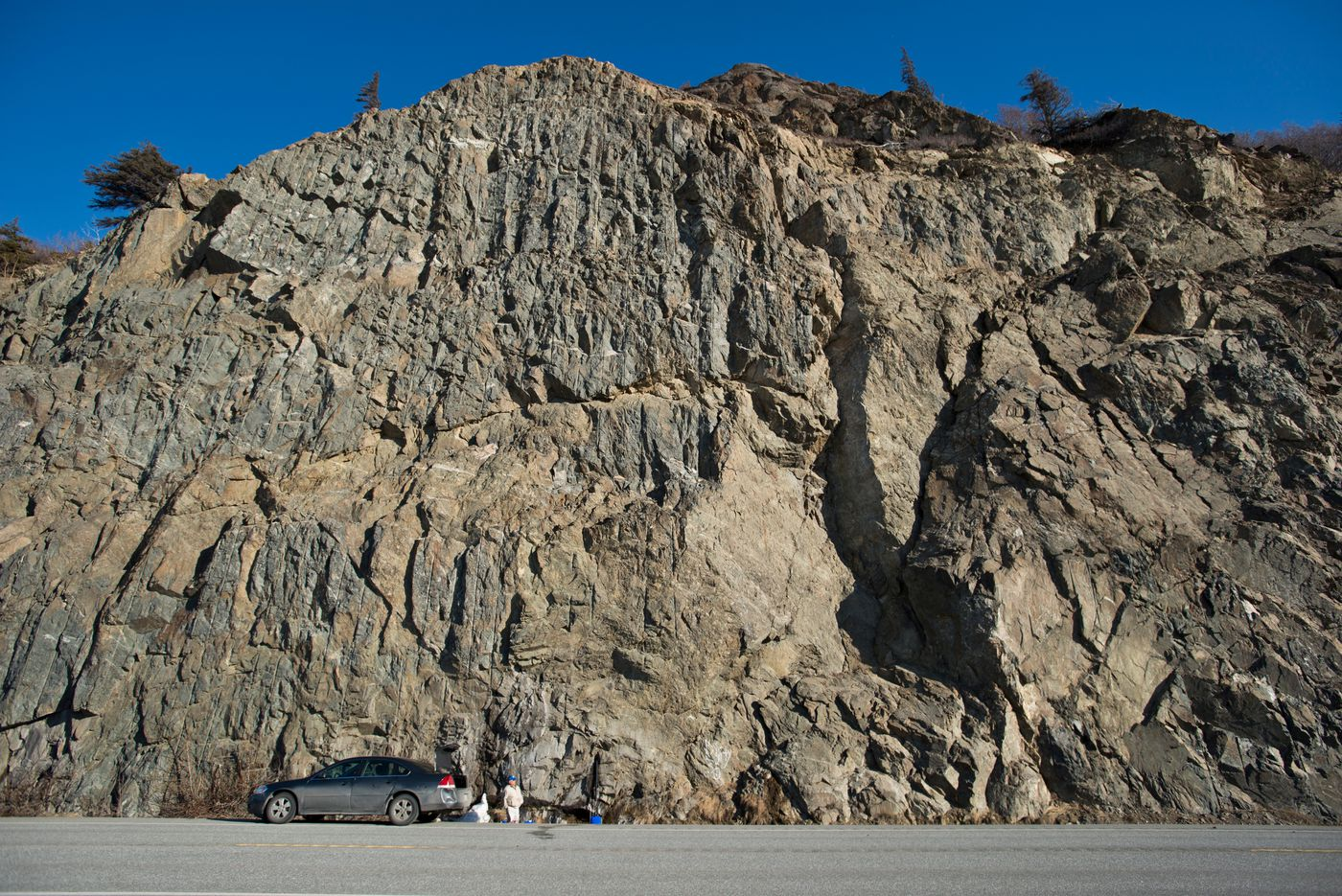 Water draining from the base of a rock wall along the Seward Highway at Mile 109 has been a popular jug-filling spot for decades. The Alaska Department of Transportation said the spot is a safety concern because of traffic and rockfall. (Marc Lester / Alaska Dispatch News)