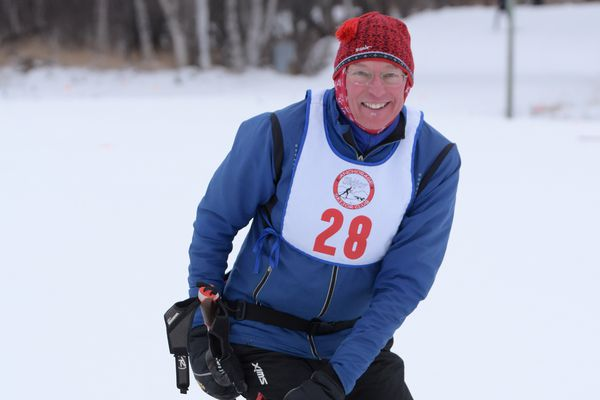 Anchorage skier Bruce Talbot did the first Tour of Anchorage in 1988 and hasn't missed one yet. He's signed up for Sunday's race, which this year will include a fat-tire bike race in the afternoon, after the ski race finishes. Talbot posed with dog Sydney at the 2018 Kincaid Classic skijor race. (Photo by David Pahlke)