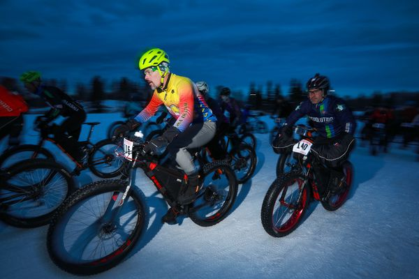 Andrew Duenow, left, and Brad Manderfeld start the 50-mile Frosty Bottom bike race Saturday, Jan. 13, 2018 at Kincaid Park. (Loren Holmes / ADN)