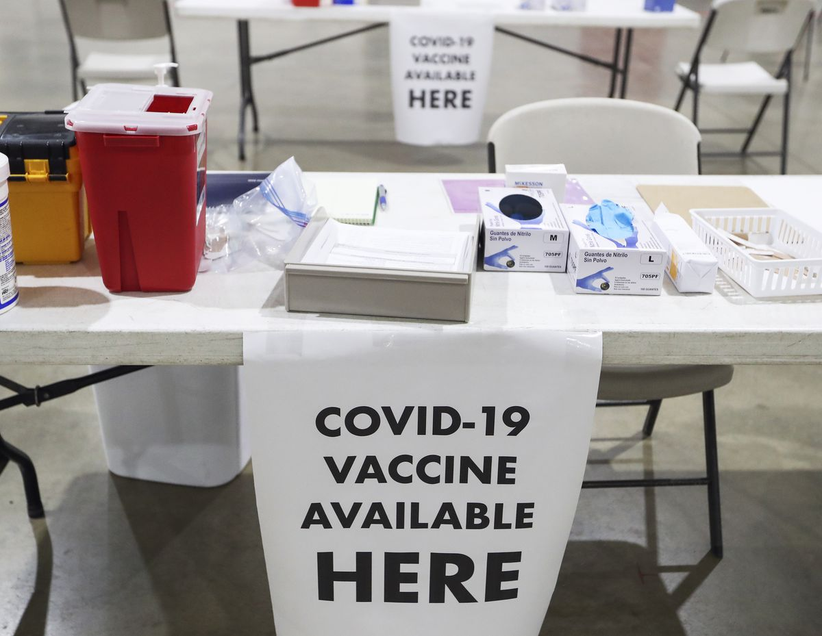 A COVID-19 vaccine clinic was set up in Raven Hall at the Alaska State Fairgrounds in Palmer, photographed on Tuesday, Jan. 12, 2021. (Emily Mesner / ADN)