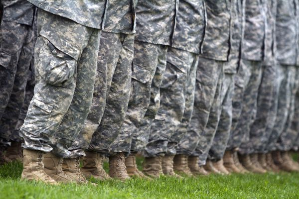 Members of the Alaska Army National Guard stand at attention during the deactivation ceremony of the 297th Battlefield Surveillance Brigade at the Alaska Army National Guard Community Day at Delaney Park Strip on Saturday, August 6, 2016. (Sarah Bell / Alaska Dispatch News)