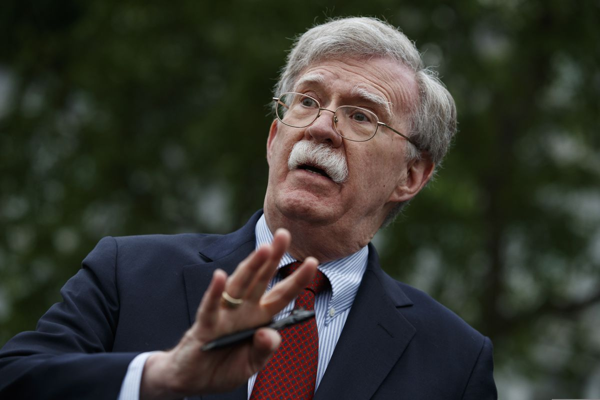 FILE - In this May 1, 2019 file photo, National Security Adviser John Bolton talks to reporters outside the White House in Washington. Trump says he fired national security adviser John Bolton, saying they 'disagreed strongly' on many issues. (AP Photo/Evan Vucci)