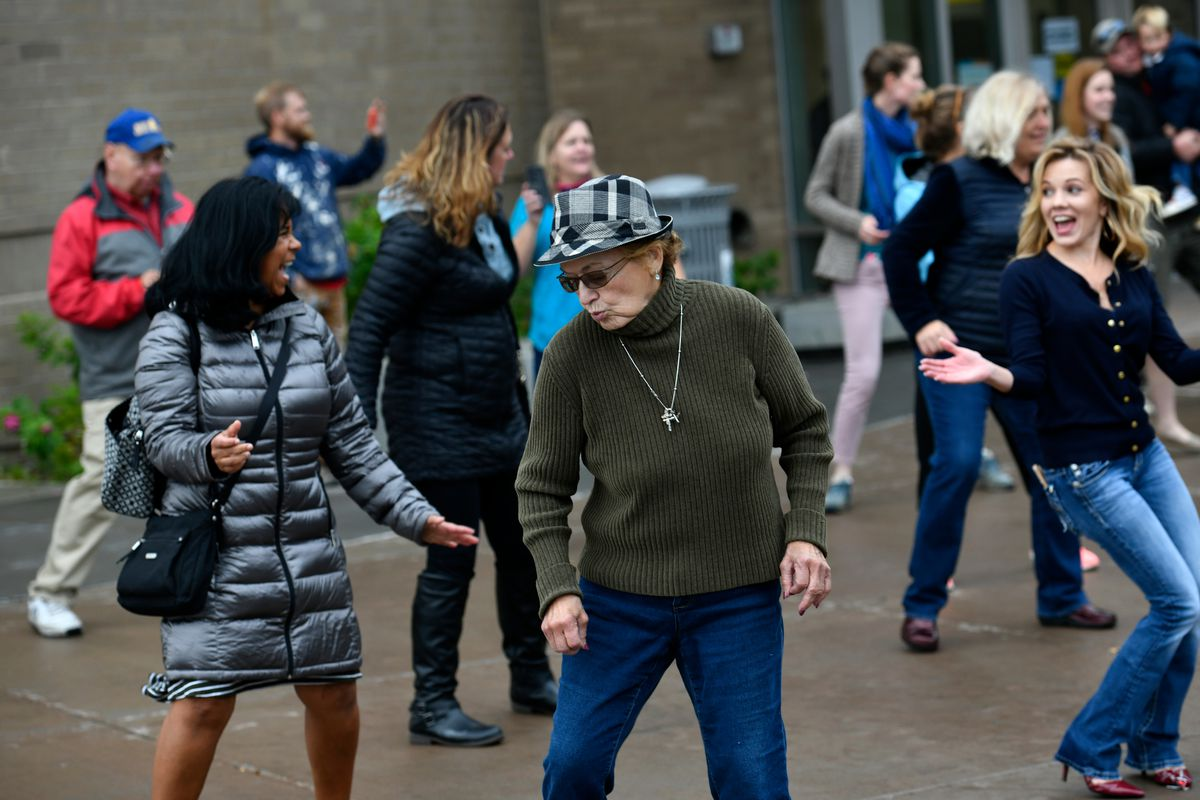 About 50 people gathered outside the Anchorage Assembly Chambers at the Loussac Library in Anchorage to dance as a form of protest to COVID-19 related business restrictions on September 15, 2020. (Marc Lester / ADN)
