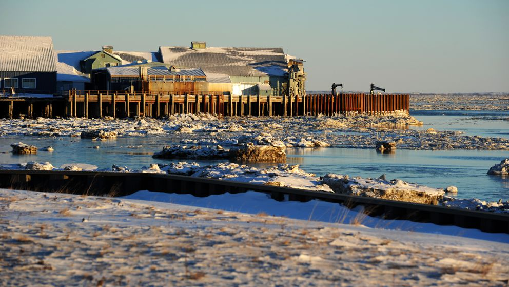 Nushagak Bay ice drifts with the tide between the seawall, foreground, and the Peter Pan Seafoods plant on Tuesday, Nov. 29, 2016, in Dillingham. (Erik Hill / ADN archive)