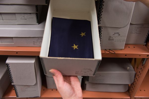Some items, like this silk Alaska flag, are stored in a locked room at the Loussac Library. (Marc Lester / ADN)