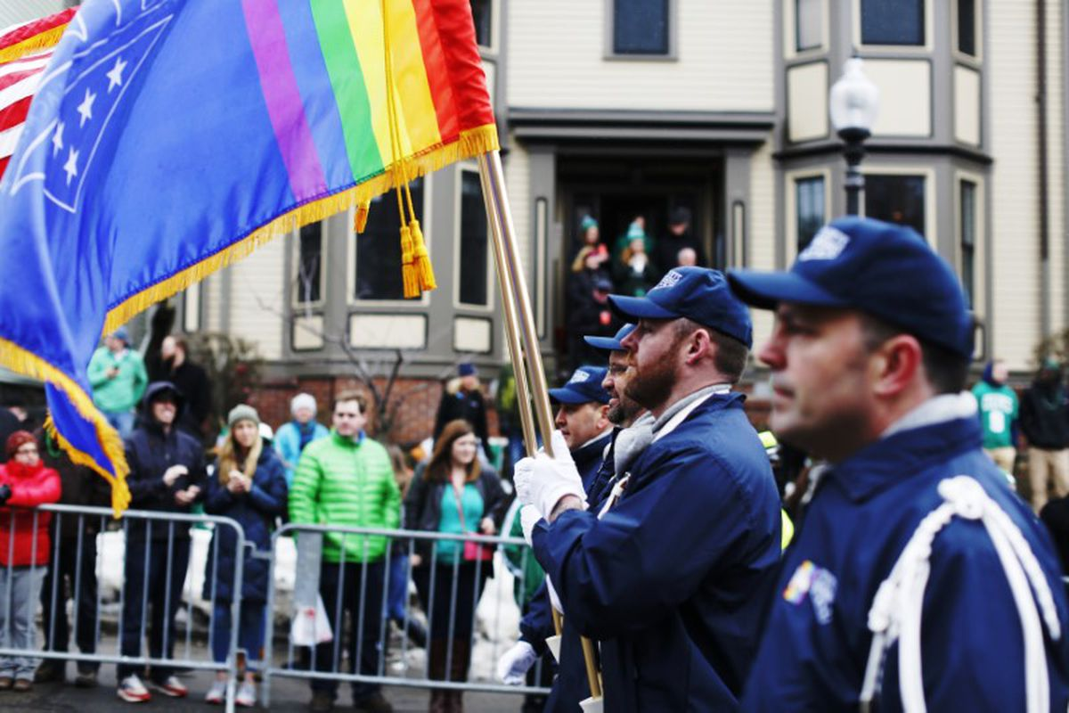 The color guard for LGBT veterans group OutVets marches down Broadway during the St. Patrick's Day Parade in South Boston, March 15, 2015. REUTERS/Dominick Reuter