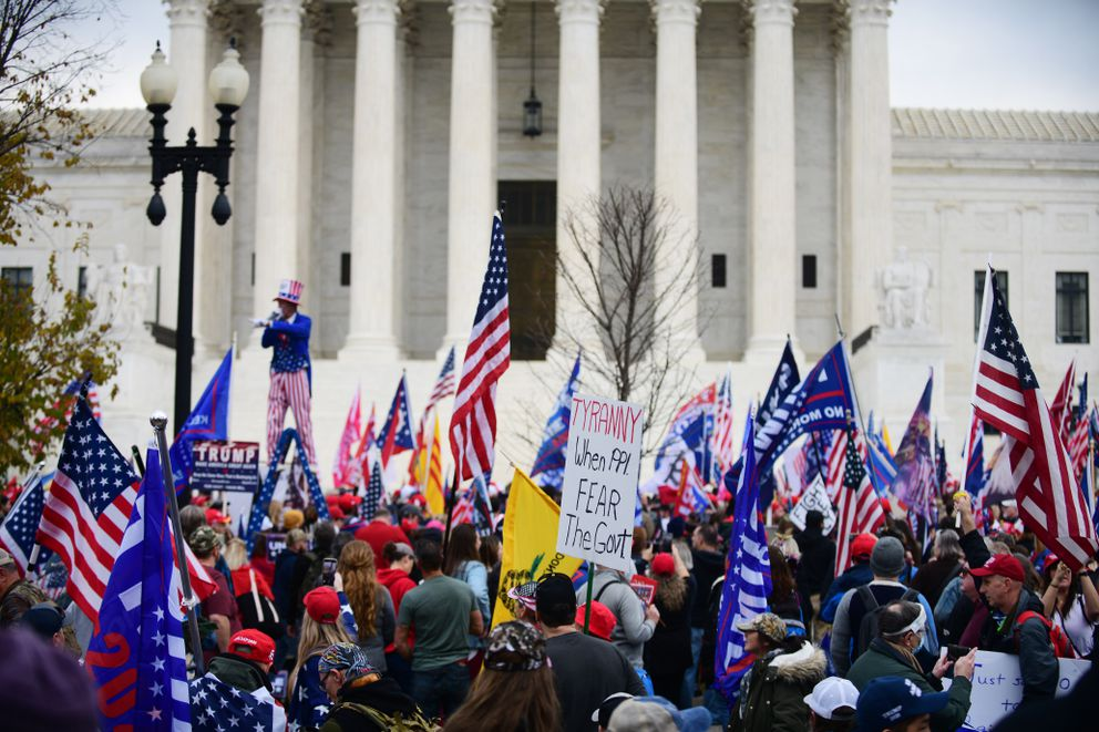 A Trump supporter dressed as Uncle Sam stands on a ladder in front of the Supreme Court in Washington D.C., where hundreds of other Trump supporters gathered on Saturday. MUST CREDIT: photo for The Washington Post by Astrid Riecken.