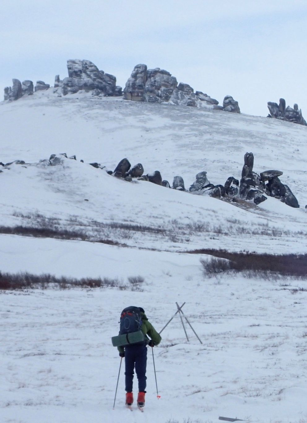 John Shook skis toward granite tors located near Serpentine Hot Springs on the Seward Peninsula. (Photo by Ned Rozell)