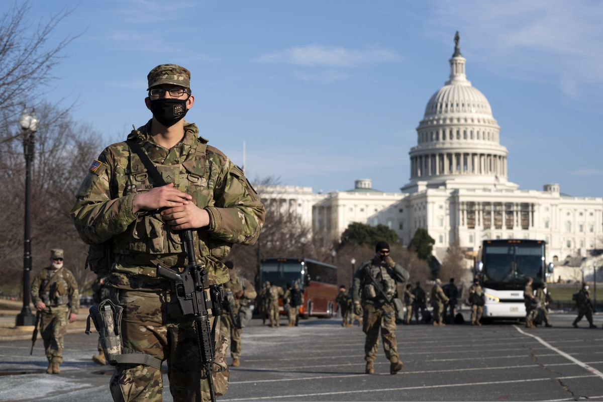 Members of the national guard patrol the area outside of the U.S. Capitol during the impeachment trial of former President Donald Trump at Capitol Hill in Washington, Tuesday, Feb. 9, 2021. (AP Photo/Jose Luis Magana)