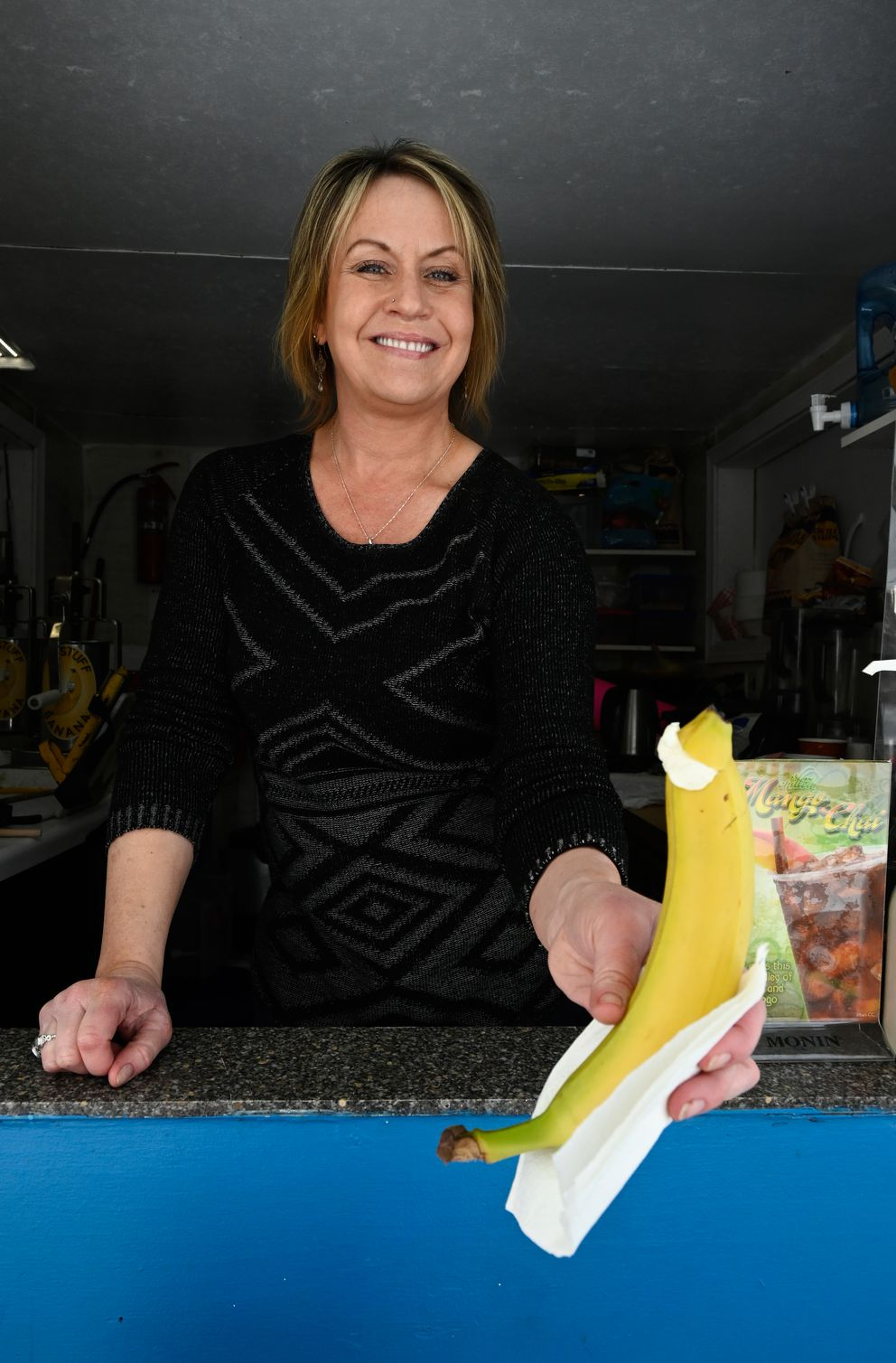 Karen House said the Nutella and cheesecake options are her best selling stuffed bananas. (Marc Lester / ADN)