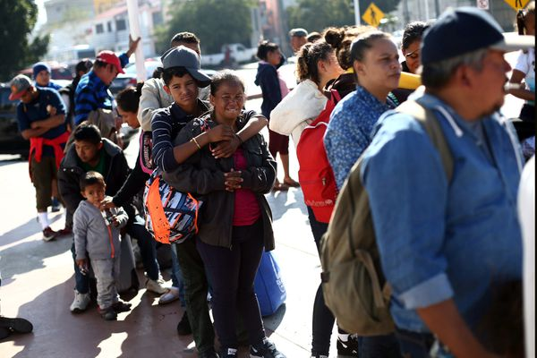 Members of a caravan of migrants from Central America, line up to enter the United States border and customs facility, where they are expected to apply for asylum, in Tijuana, Mexico May 4, 2018. REUTERS/Edgard Garrido