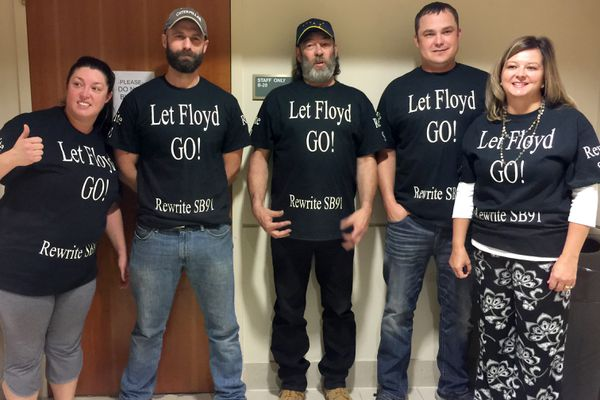 Doria Clark, Daniel Miller, Floyd Hall, Chad Martin and Candis Bishop wear t-shirts supporting Hall at his arraignment on a reckless driving charge on Oct. 3, 2017 at the Nesbett Courthouse in Anchorage. The group says Hall should not be punished for his volunteer efforts to recover stolen vehicles. (Michelle Theriault Boots / Alaska Dispatch News)