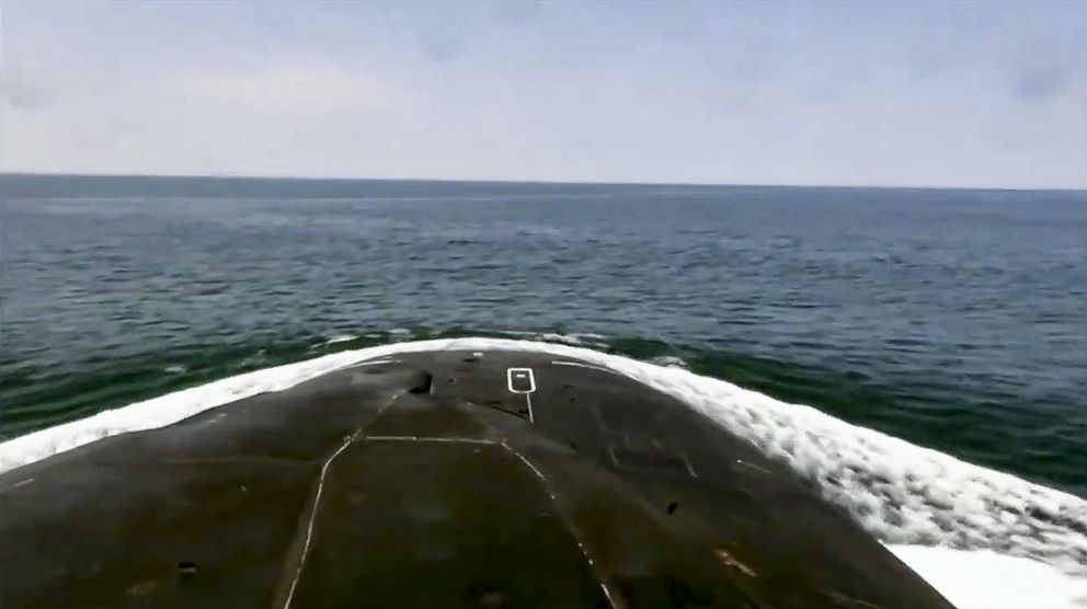In this undated video grab provided by Russian Defense Ministry Press Service, a Russian submarine surfaces during naval manoeuvres in the Bering Sea. The Russian navy has conducted massive war games near Alaska involving dozens of ships and aircraft, the biggest such drills in the area since the Soviet times. (Russian Defense Ministry Press Service via AP)