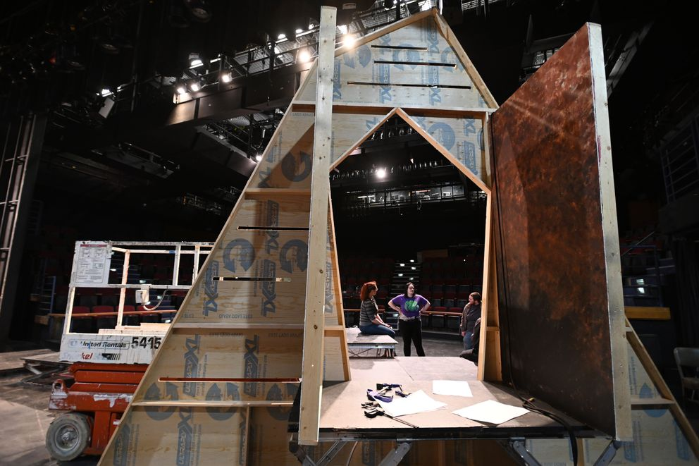 UAA theater students talk about the program being eliminated while working on the set for the upcoming play 'Machinal ' on Tuesday. (Bill Roth / ADN)